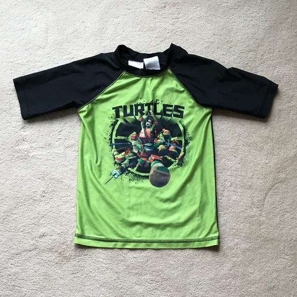 3561bcc191 Teenage Mutant Ninja Turtles Rash Guard. Nickelodeon.  M_5ad15dbcdaa8f6516492f1fd. M_5ad15dbe9d20f02fd7a5cd48.  M_5ad15dbfa825a6e46cfb7503
